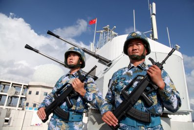 Philippines says China blocking access South China Sea atoll.