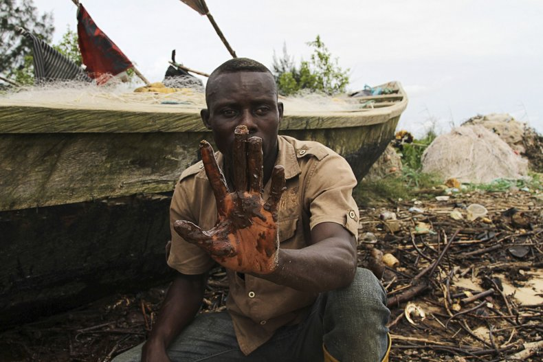 A Niger Delta fisherman shows an oil slick.