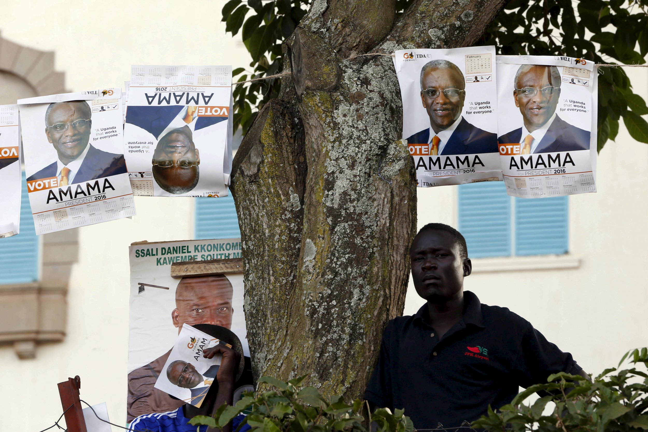 An Amama Mbabazi supporter rests during a campaign rally.