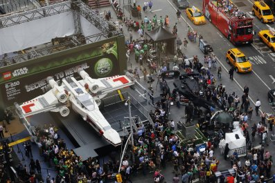 Star Wars X wing in Times Square surrounded by crowds