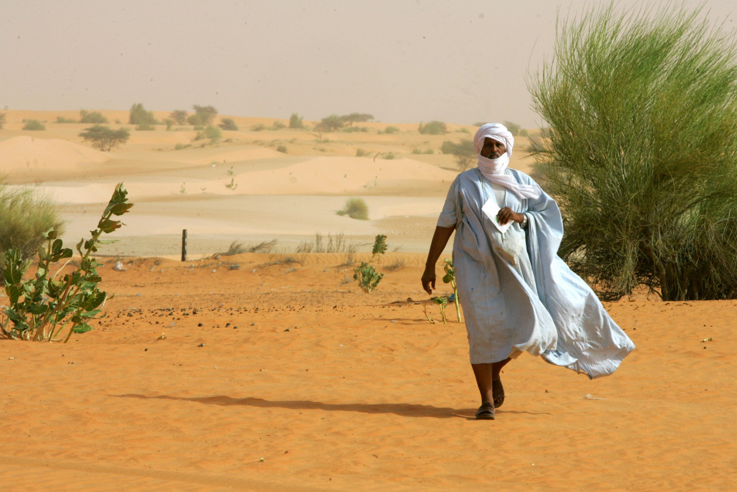 A Mauritanian voter walks to a polling station.