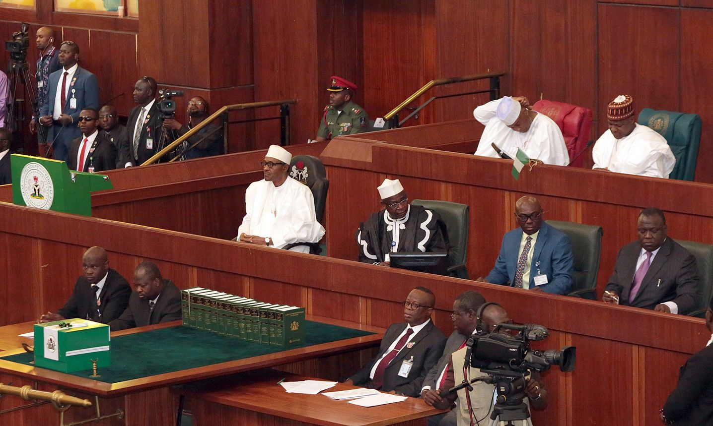 President Buhari sits in Nigeria's National Assembly after submitting his budget.