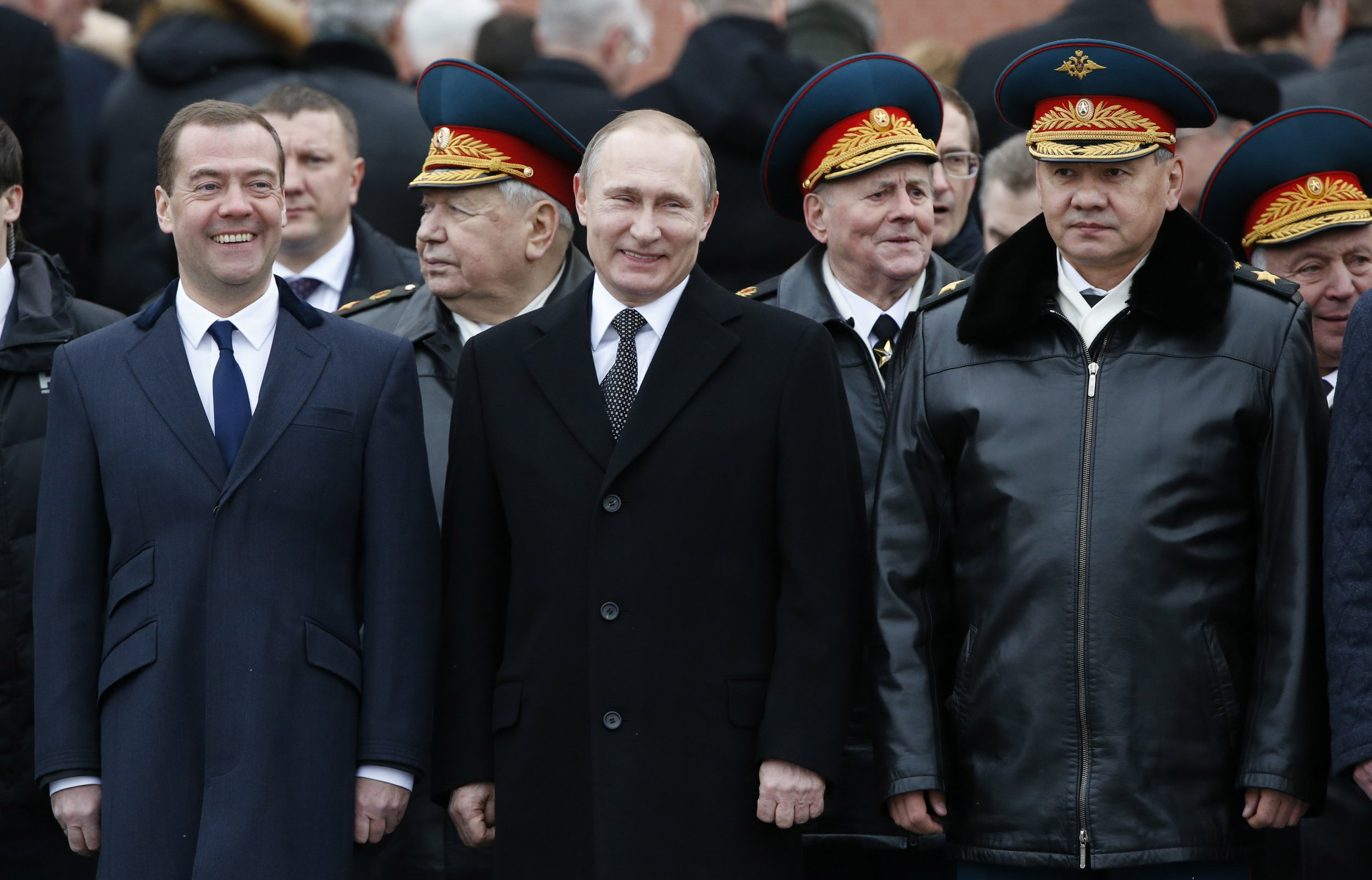 Putin Medvedev and Shoigu smile on the Red Square
