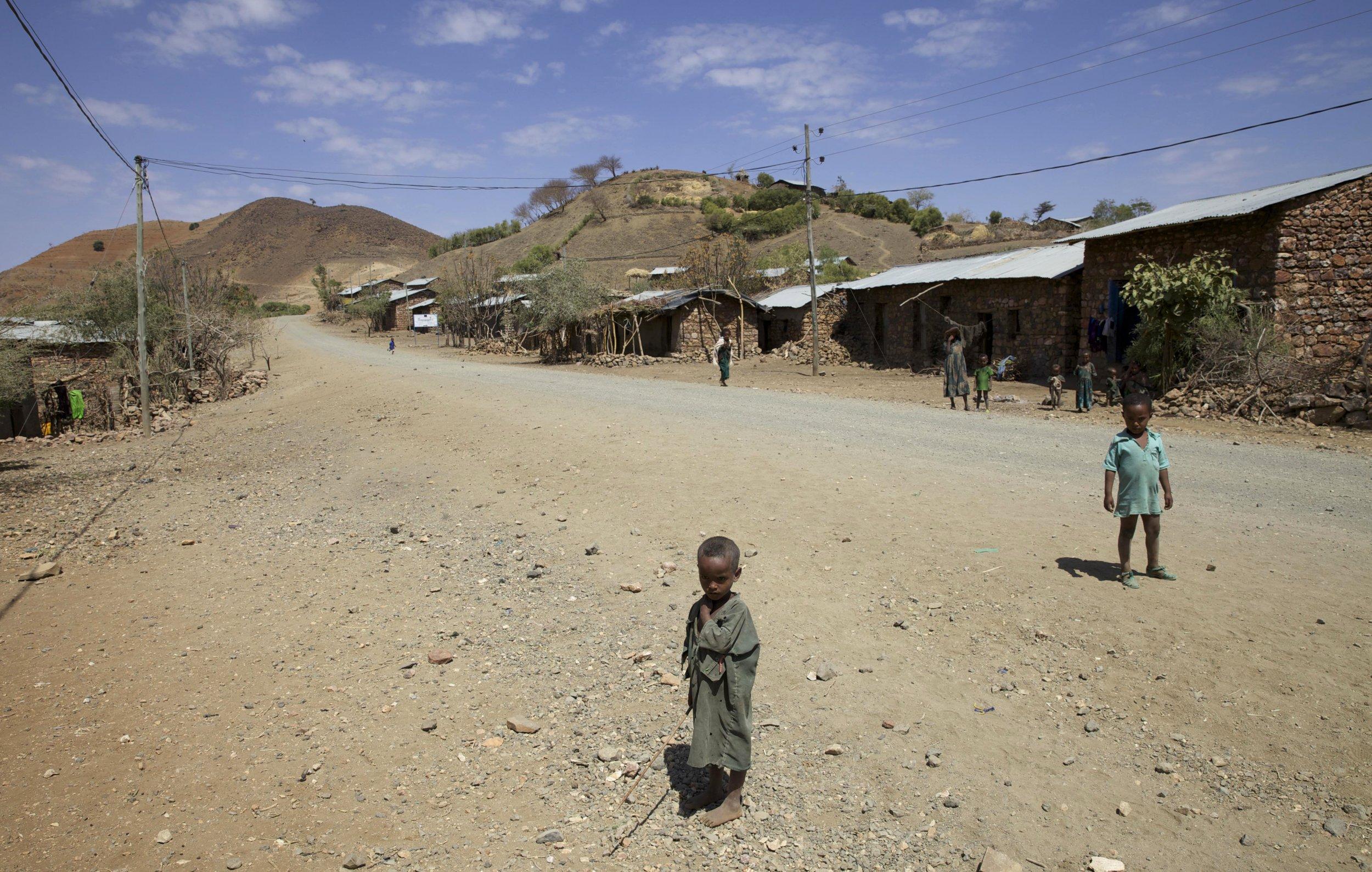 Ethiopian children stand in the road.