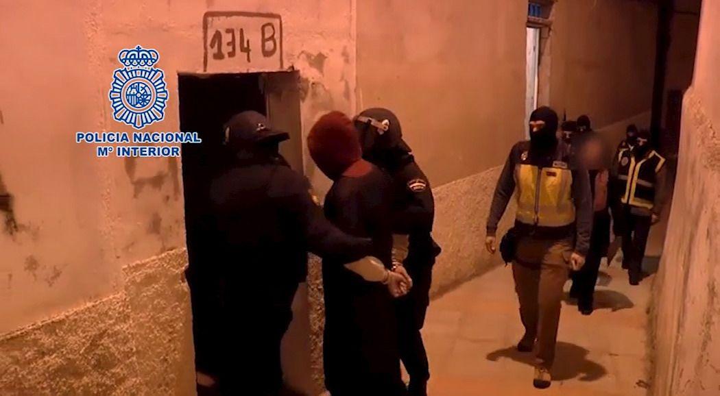 Police arrest masked suspects