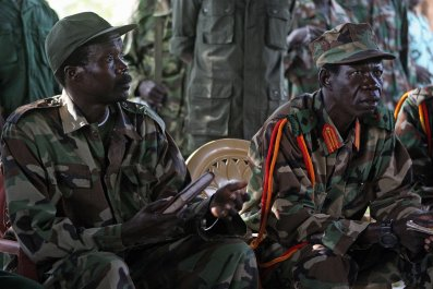 Lord's Resistance Army leader Joseph Kony sits at a meeting with a U.N. representative.