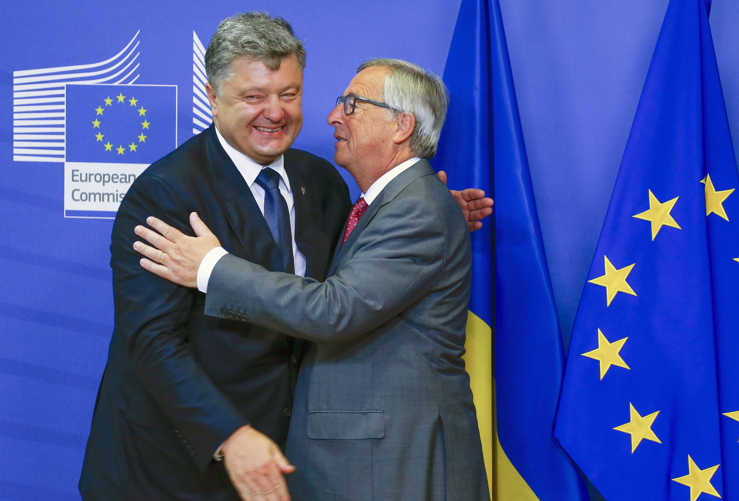 Poroshenko and Juncker hug