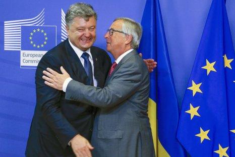 Poroshenko and Juncker hug