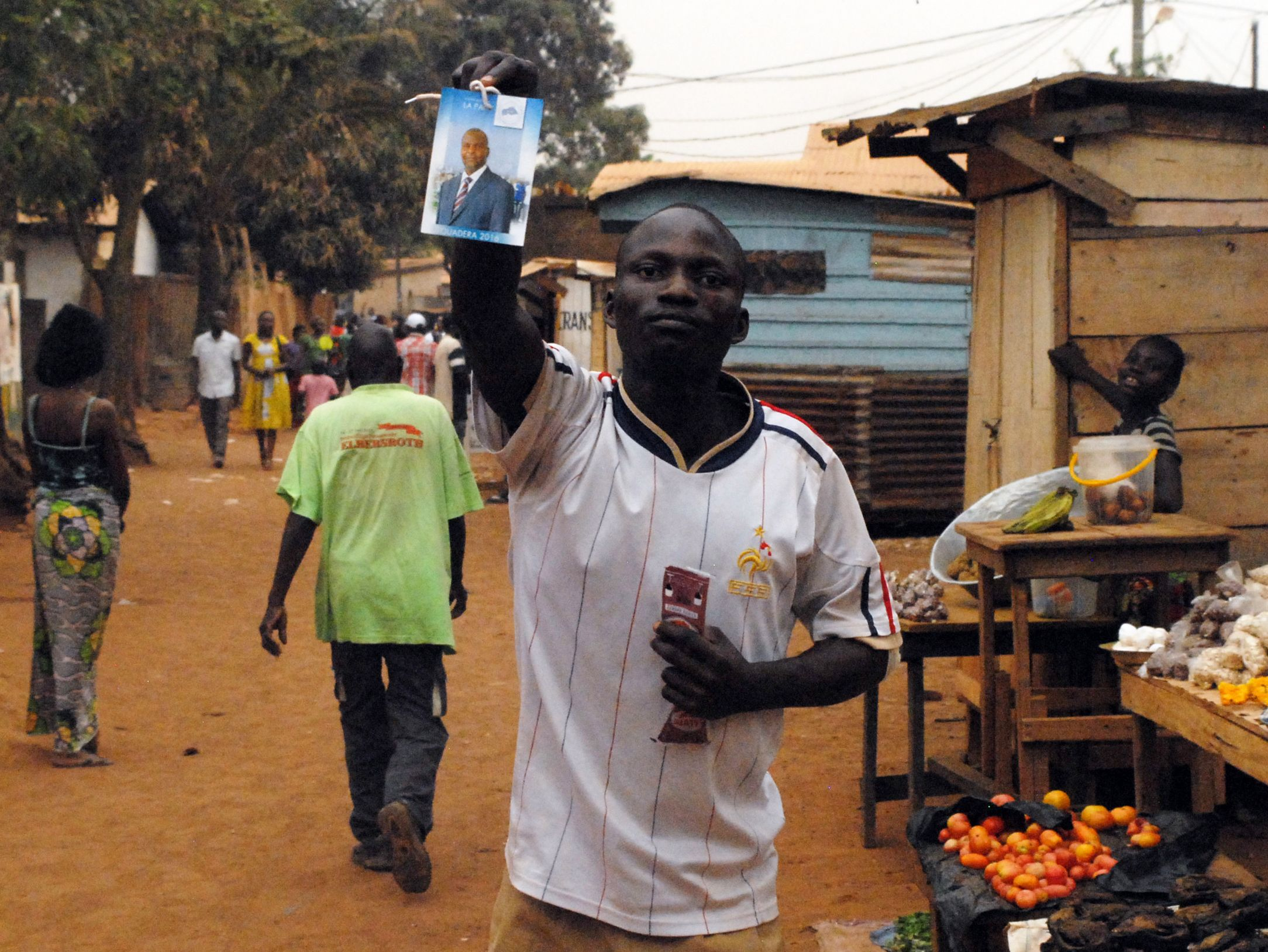 A supporter of Central African Republic's new president Faustin Archange Touadera celebrates.