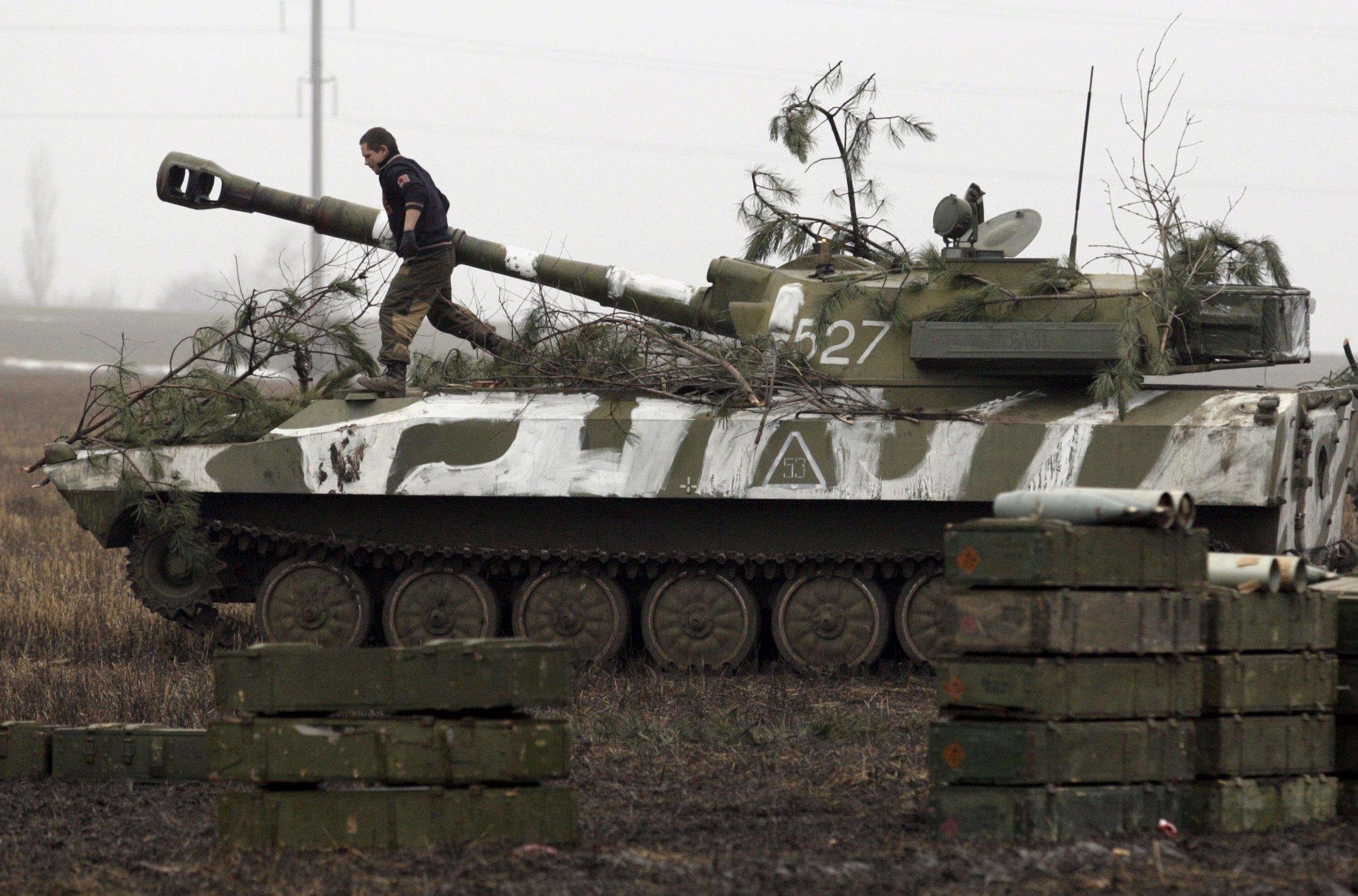 pro-Russian rebel walks on tank