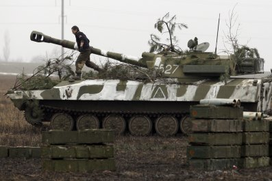 pro-Russian rebel walks on tank