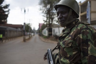 A Kenyan police officer stands guard near the Westgate mall.