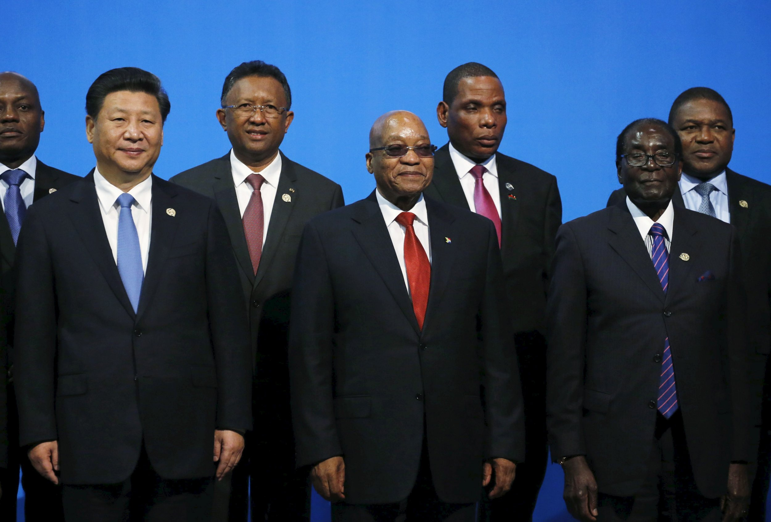 China's Xi Jinping poses with Robert Mugabe and Jacob Zuma.