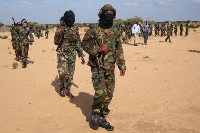 Al-Shabab fighters march in Somalia.