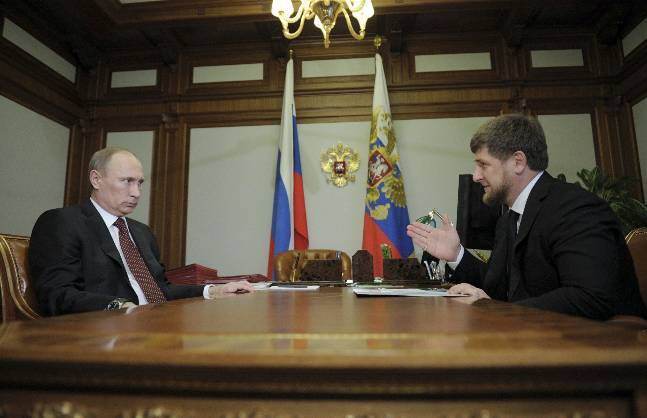 Putin glares at Kadyrov