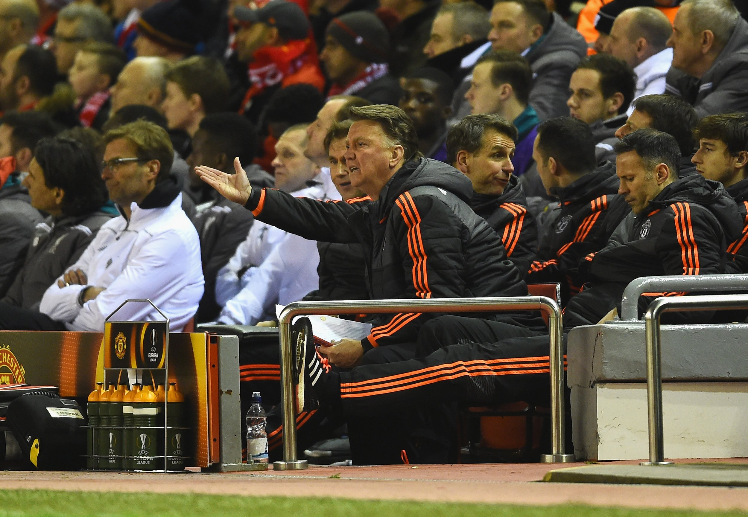 Louis Van Gaal watches Manchester United slip to defeat at Anfield.