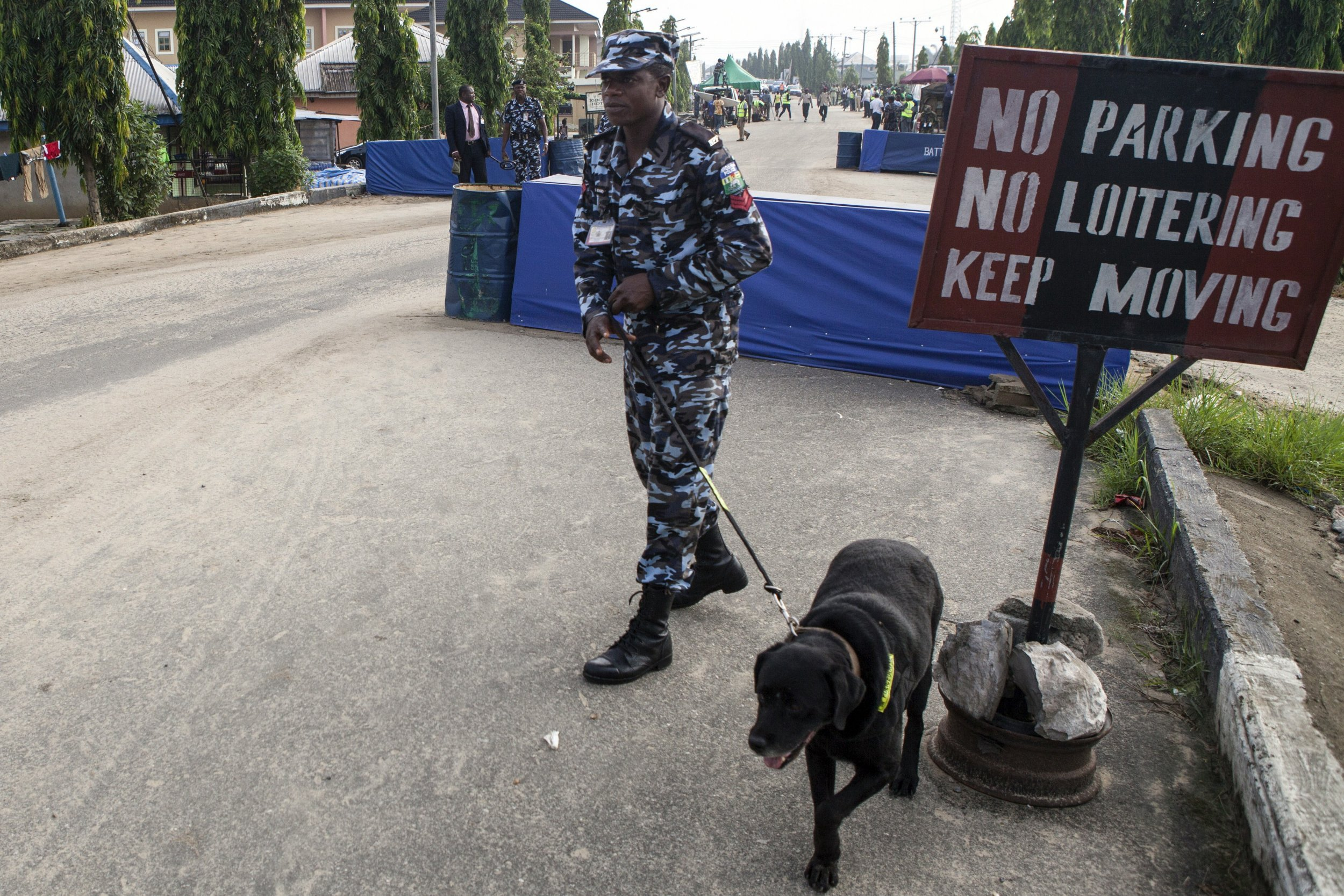 A Nigerian police officer and dog patrol in Bayelsa state.