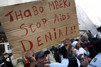 A TAC activist campaigns against Thabo Mbeki's HIV stance in Cape Town.