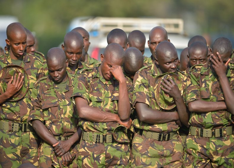 Kenyan soldiers mourn their comrades killed by Al-Shabab.