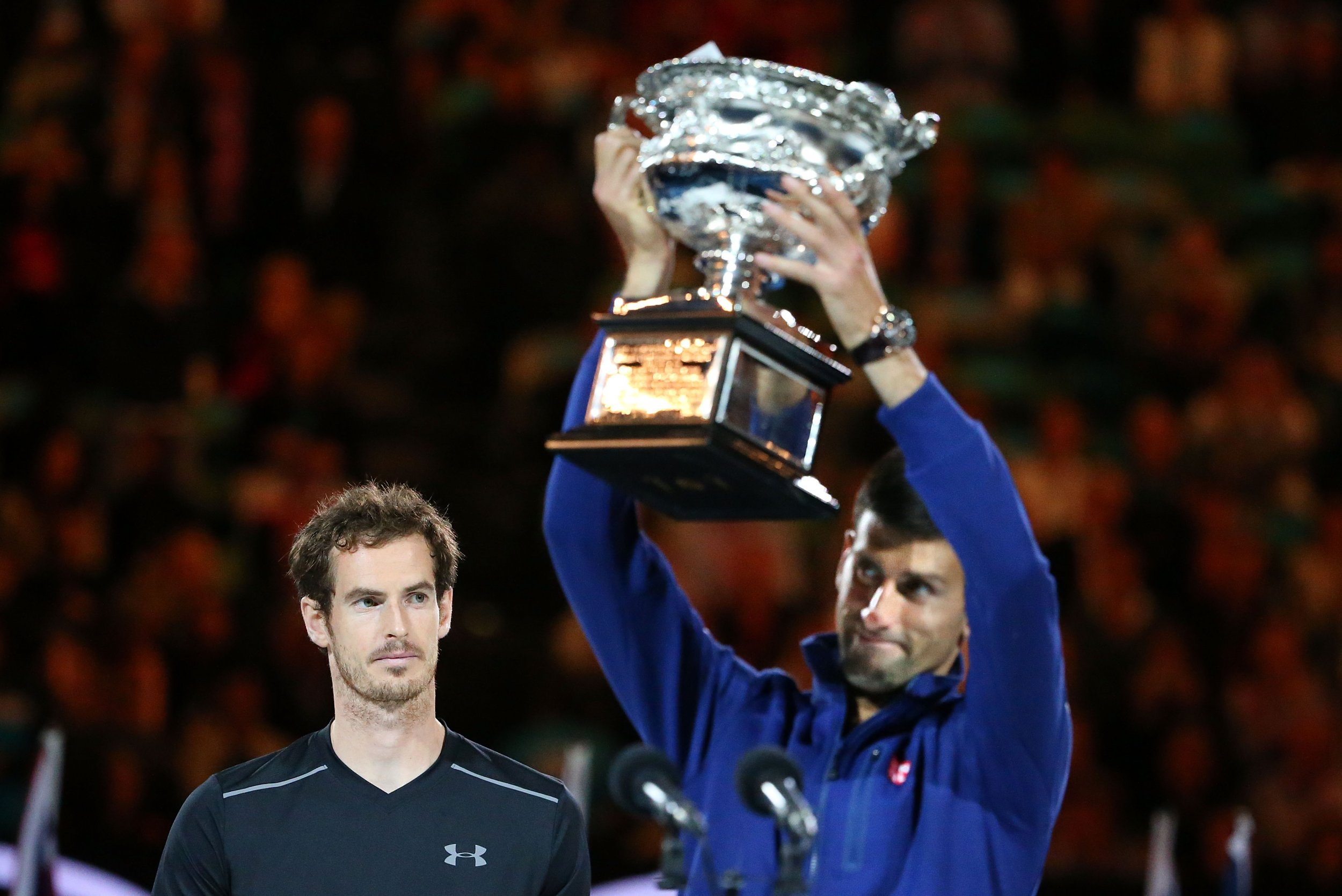 Novak Djokovic lifts the 2016 Australian Open trophy after beating Britain's Andy Murray.