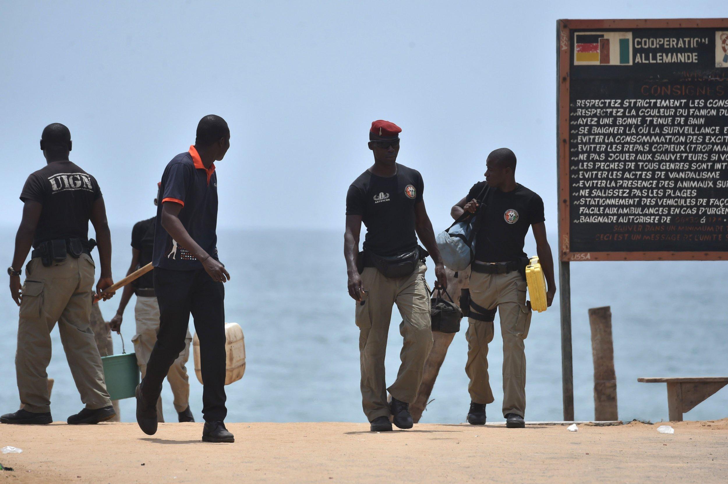 Mine clearance experts at the Grand Bassam beach resort in Ivory Coast.