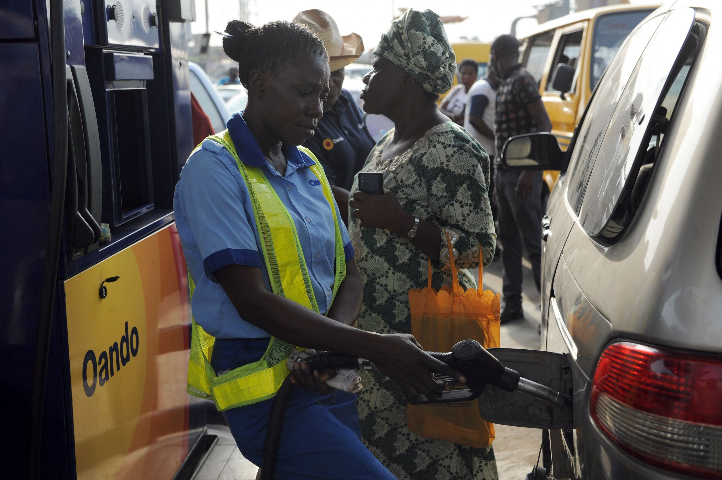 A Nigerian gas attendant fills a vehicle in Lagos.