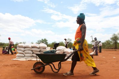 A Zimbabwean villager collects food rations from the U.N. World Food Program.