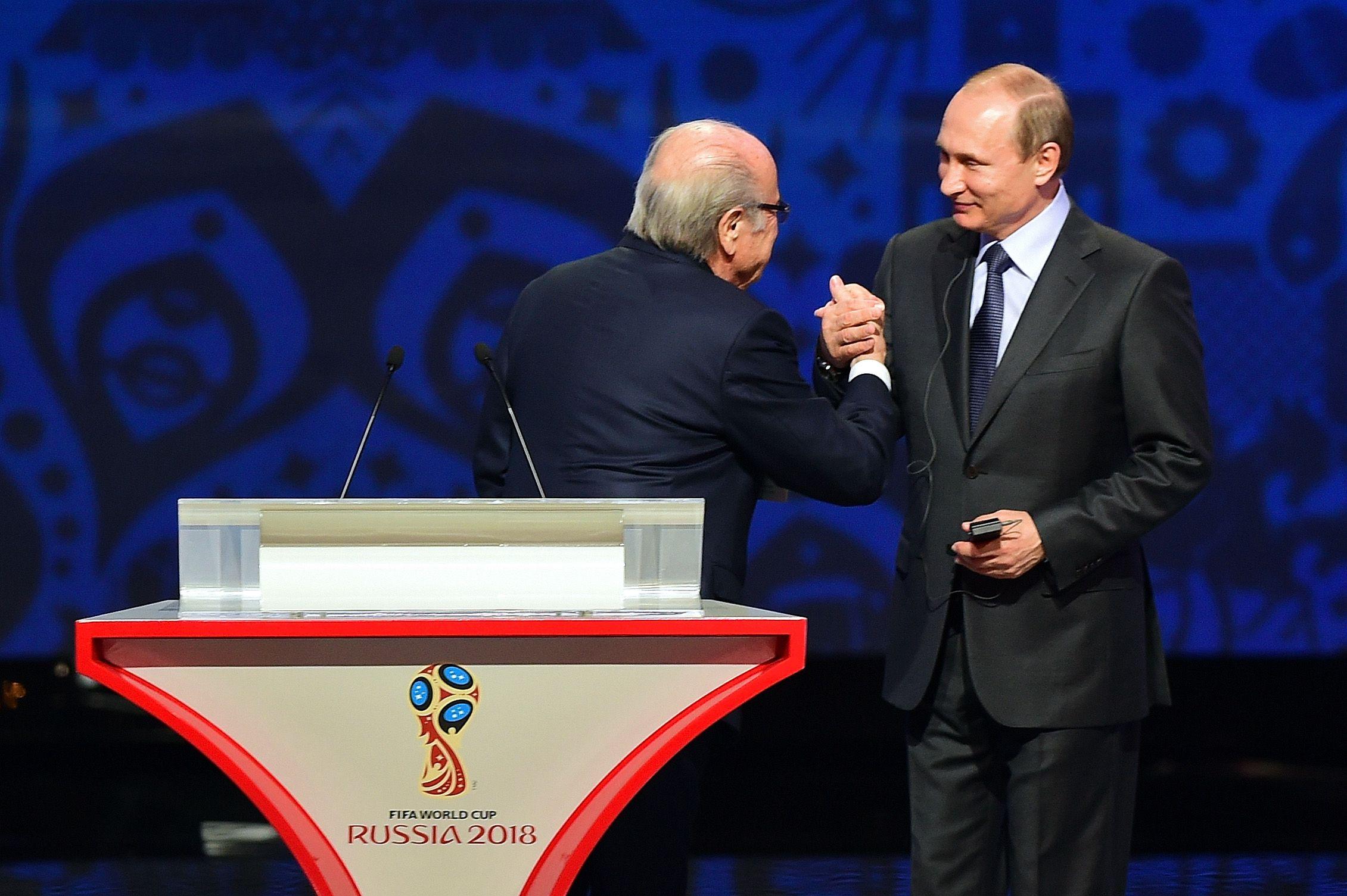 Former FIFA President Sepp Blatter with Russian President Vladimir Putin in St Petersburg, July 2015.