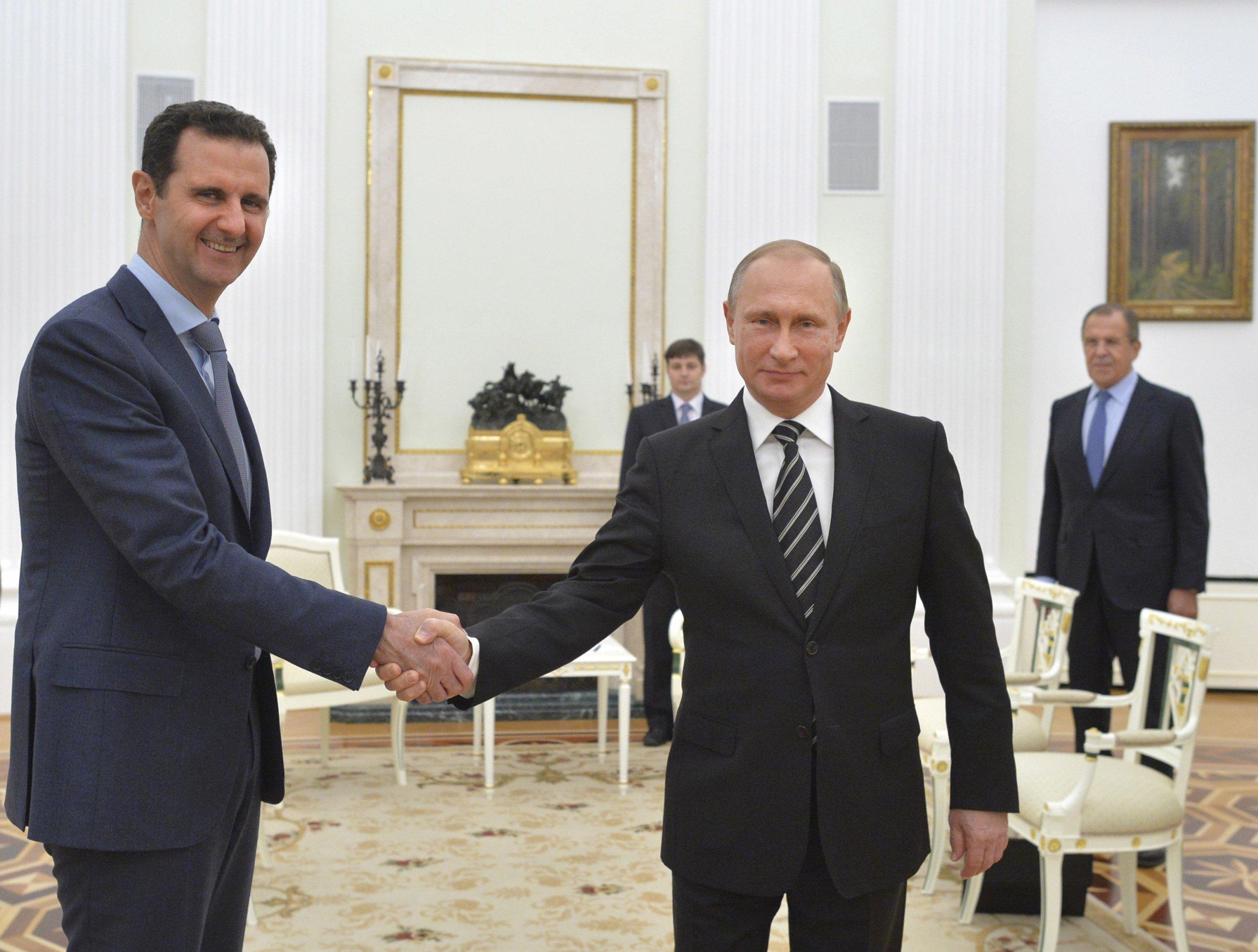 Putin and Assad shake hands