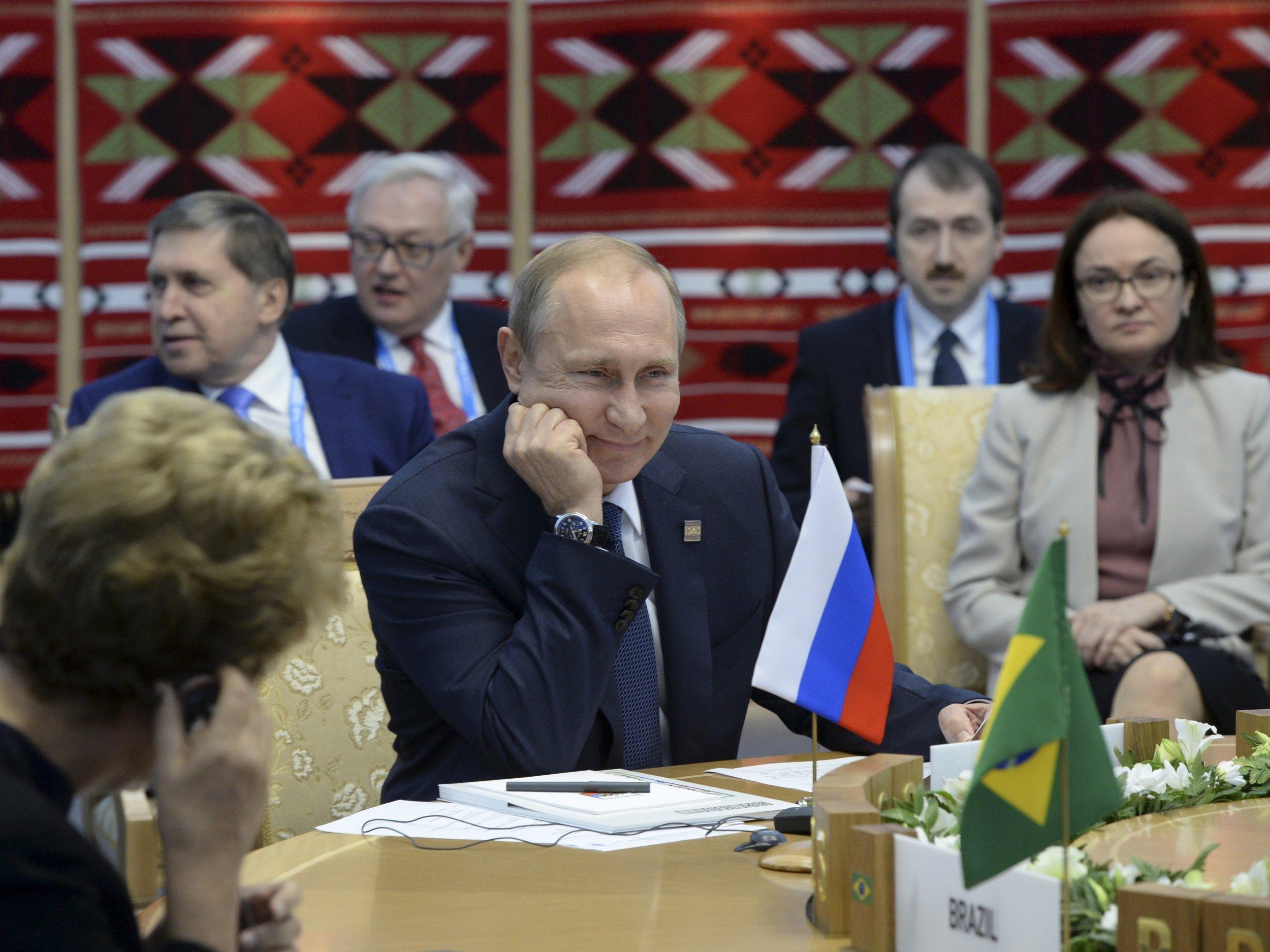 Putin smiles