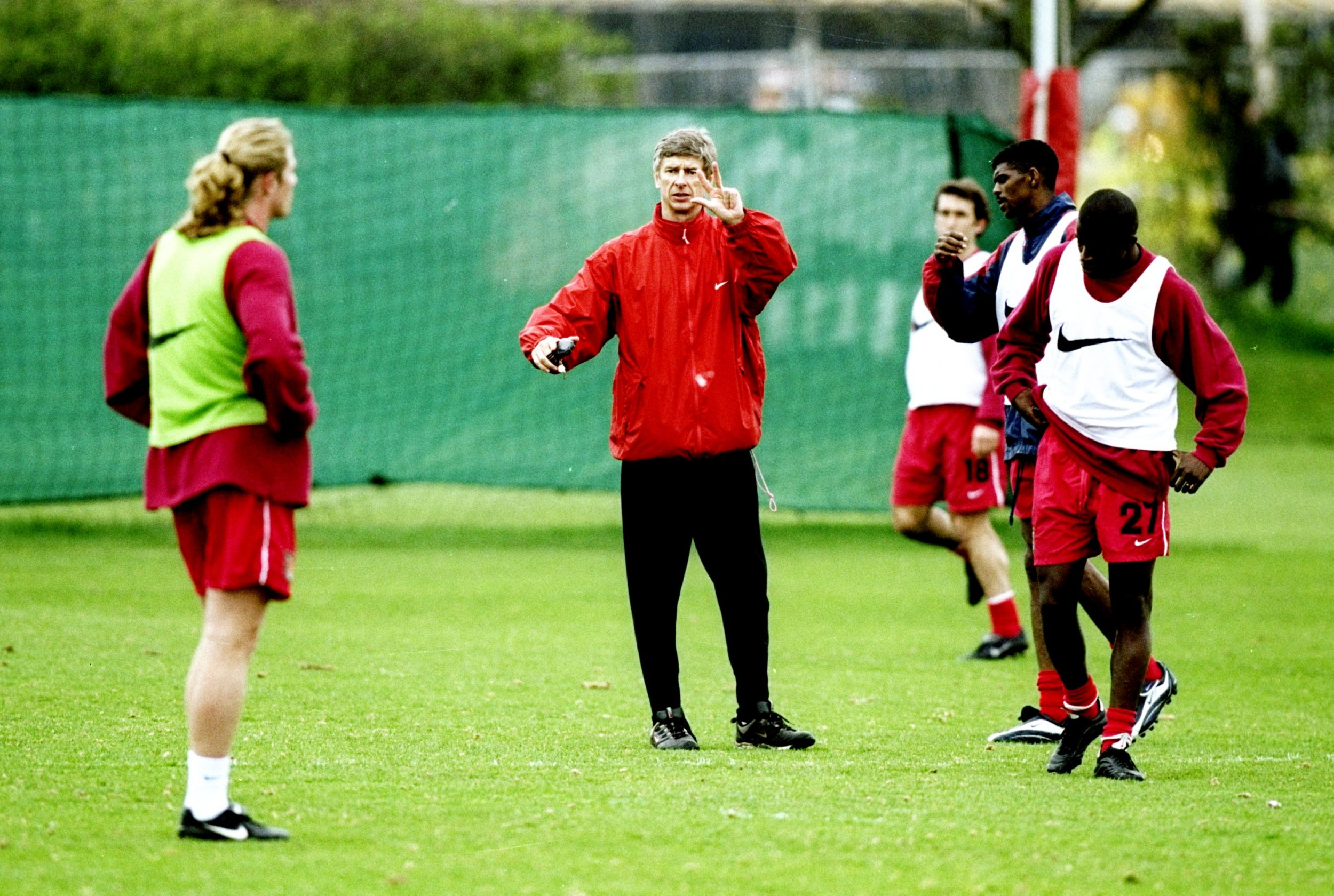 Emmanuel Petit, left, and Arsenal manager Arsene Wenger in training, April 1999.