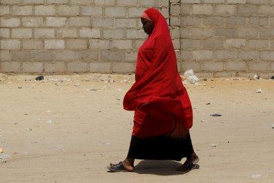 A woman walks in an IDP camp in Maiduguri, Nigeria.