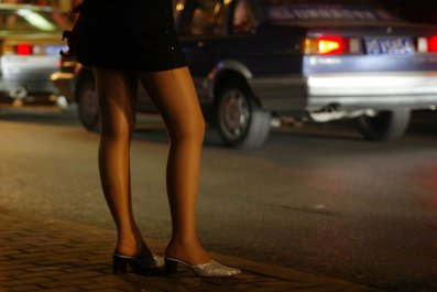 A prostitute in Shanghai waits for customers.