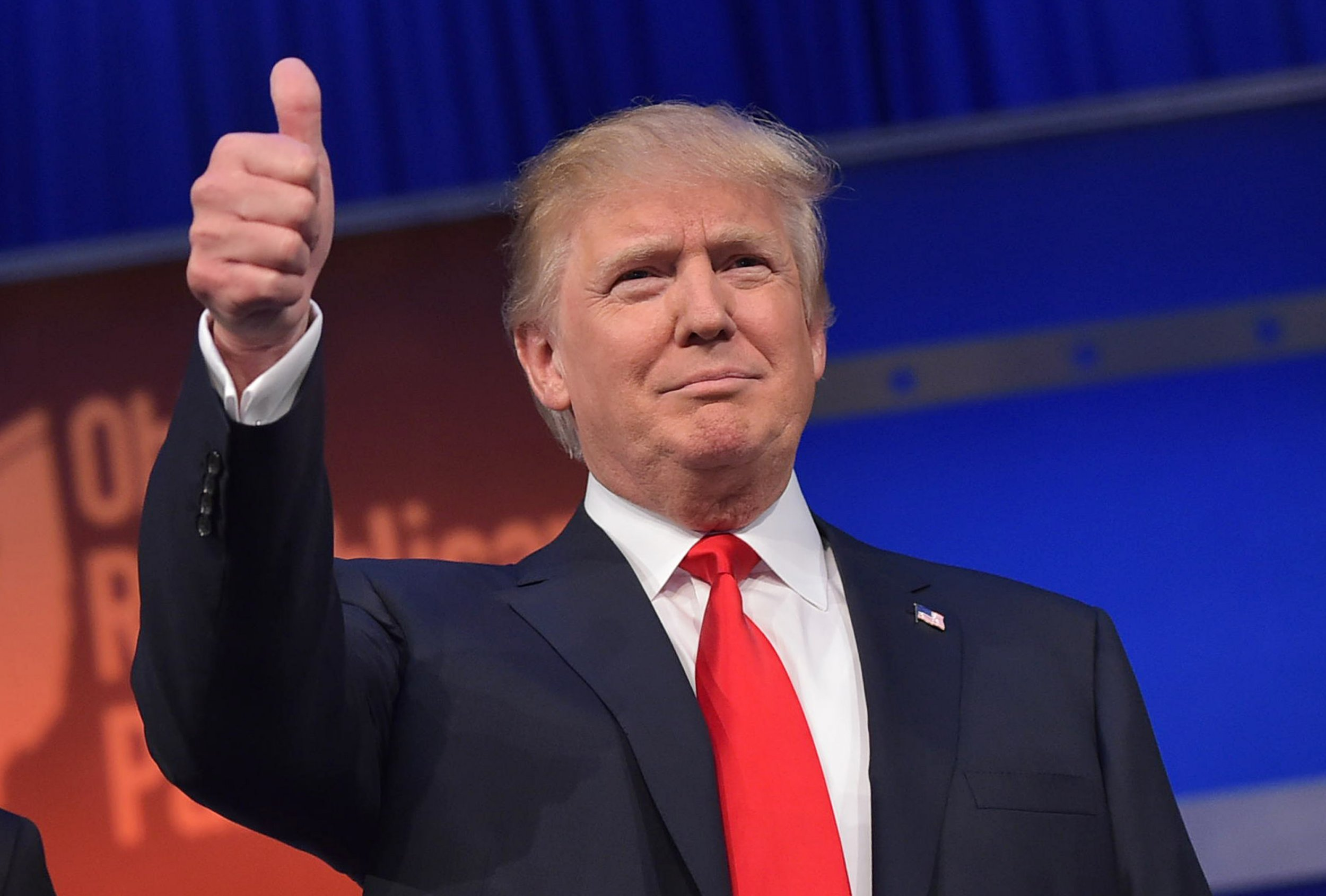 Republican candidate Donald Trump gives a thumbs-up.
