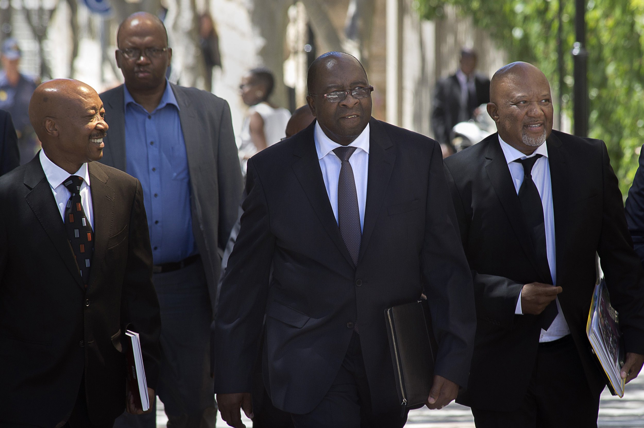 Nhlanhla Nene walks alongside Mcebisi Jonas in Cape Town.