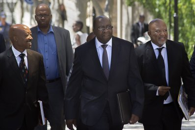Nhlanhla Nene walks alongside Mcebisi Jonas in Cape Town.
