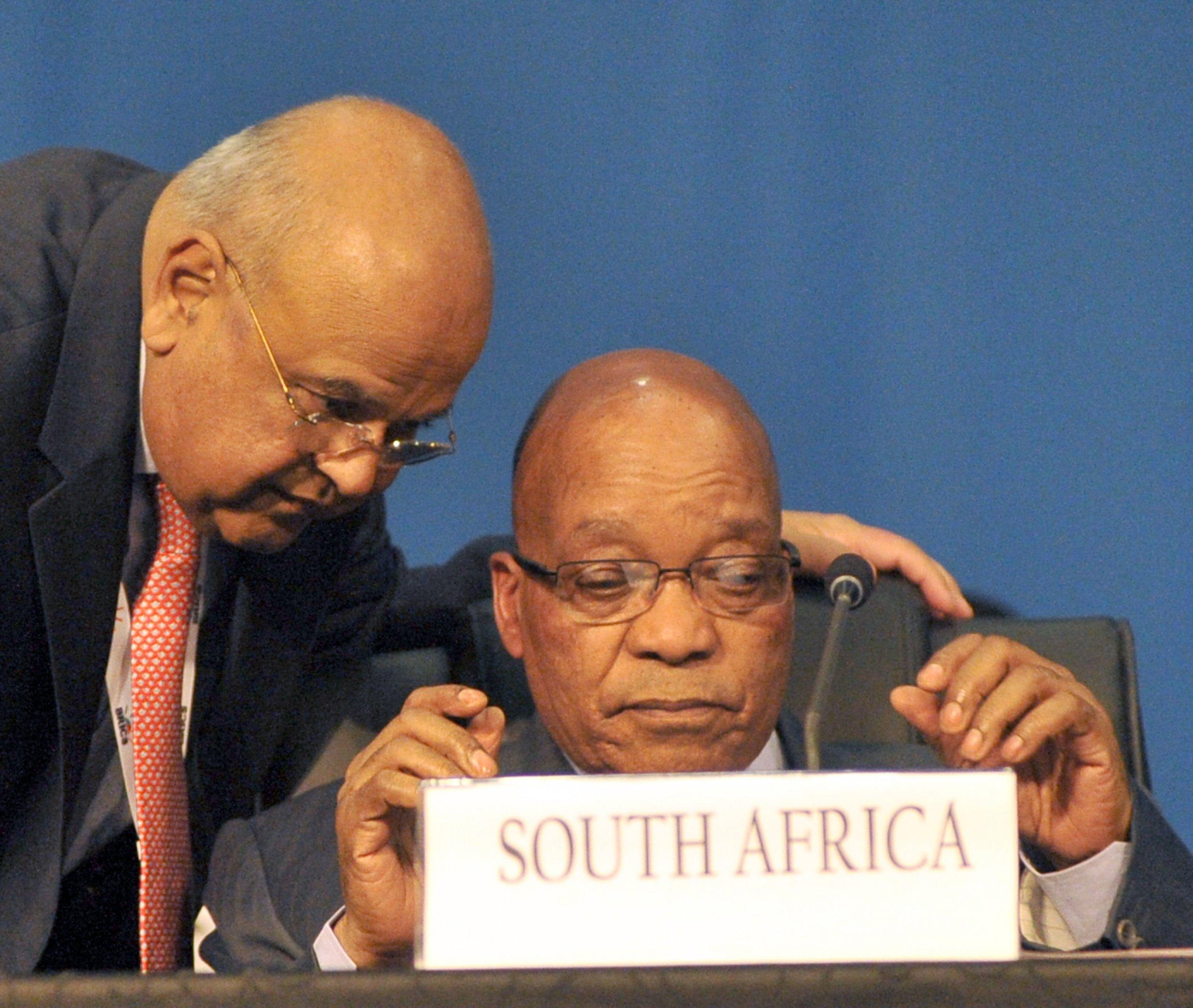 Jacob Zuma and Pravin Gordhan speak at a BRICS summit in Durban.