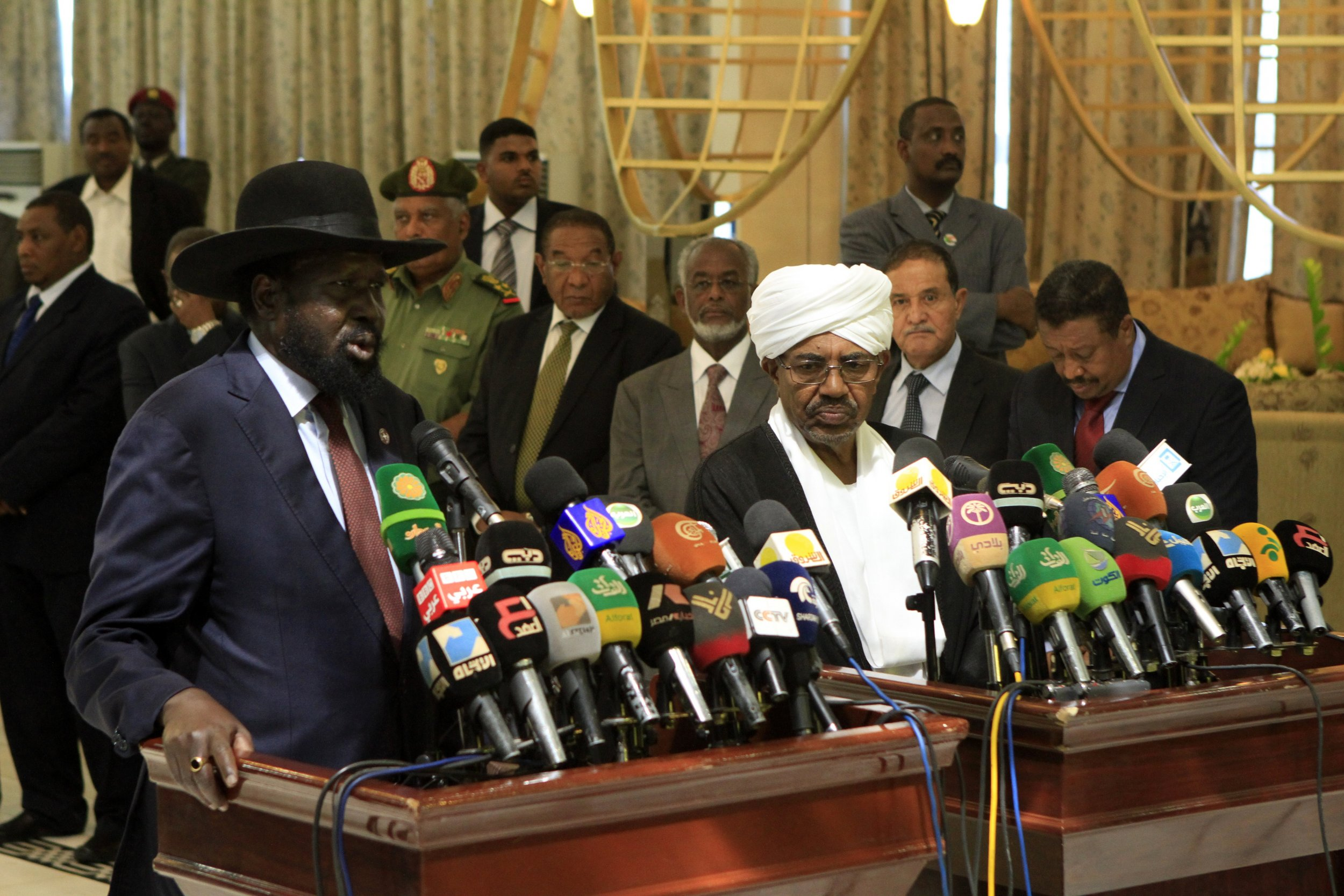 South Sudan President Salva Kiir and Sudan President Omar al-Bashir speak in Khartoum.