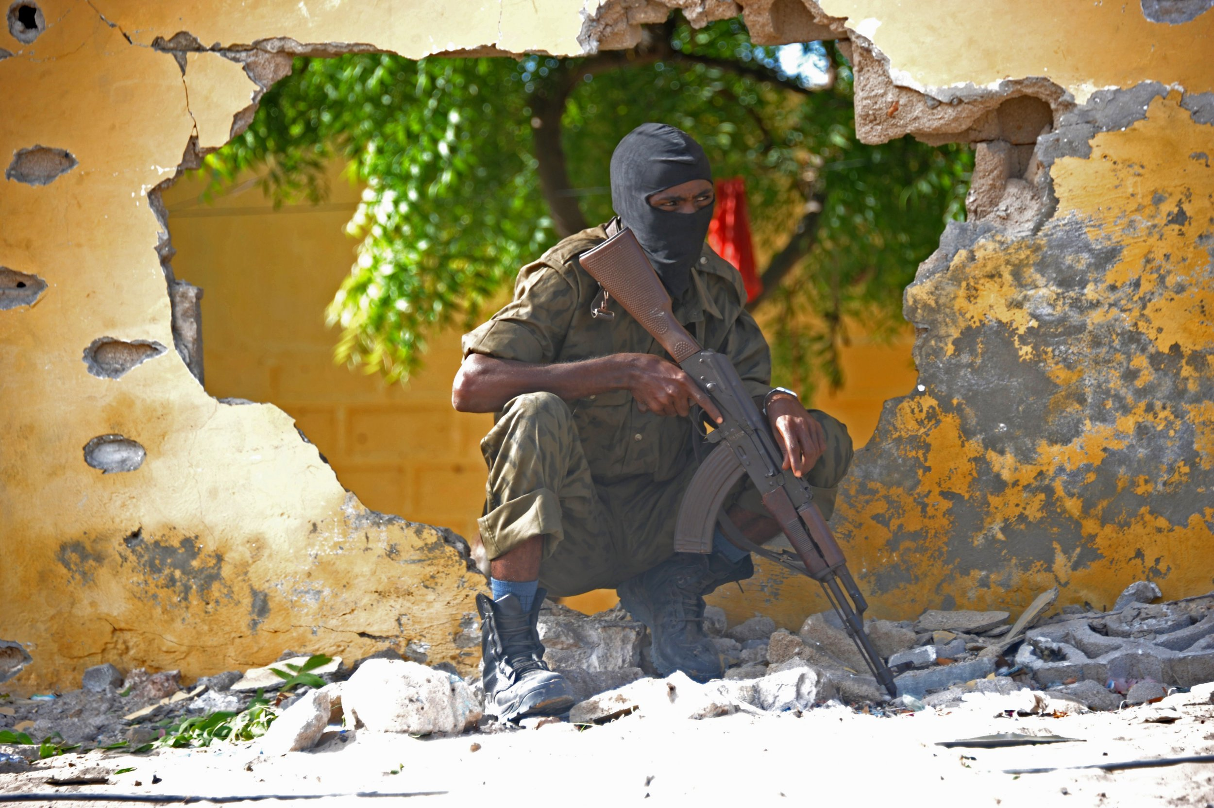 A Somali soldier stands guard after an Al-Shabab attack.