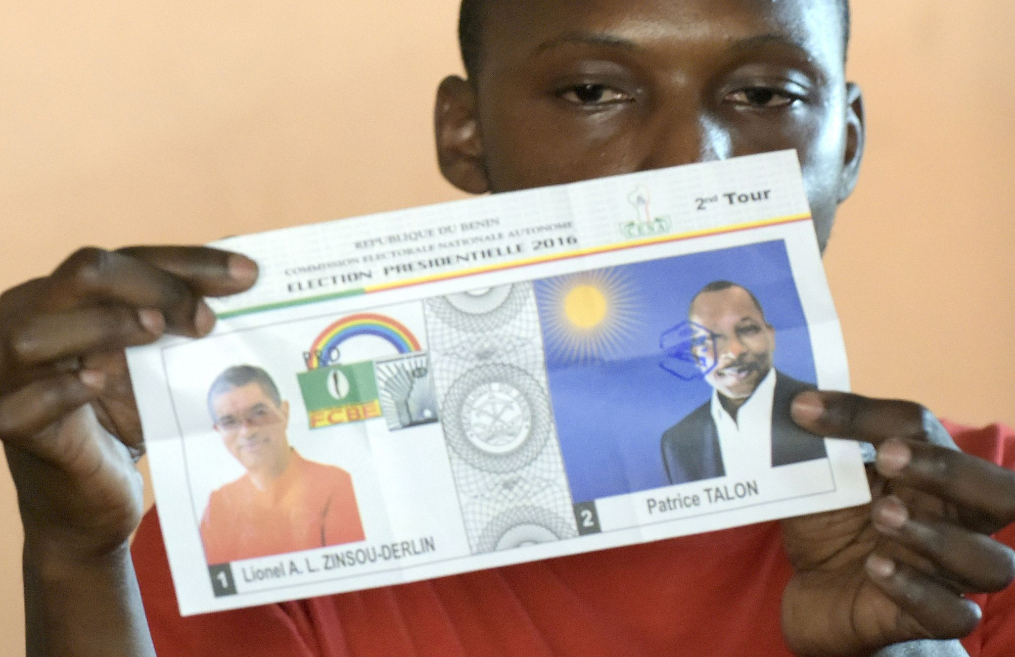 A Beninese electoral official counts votes after the second round of Benin's presidential election.