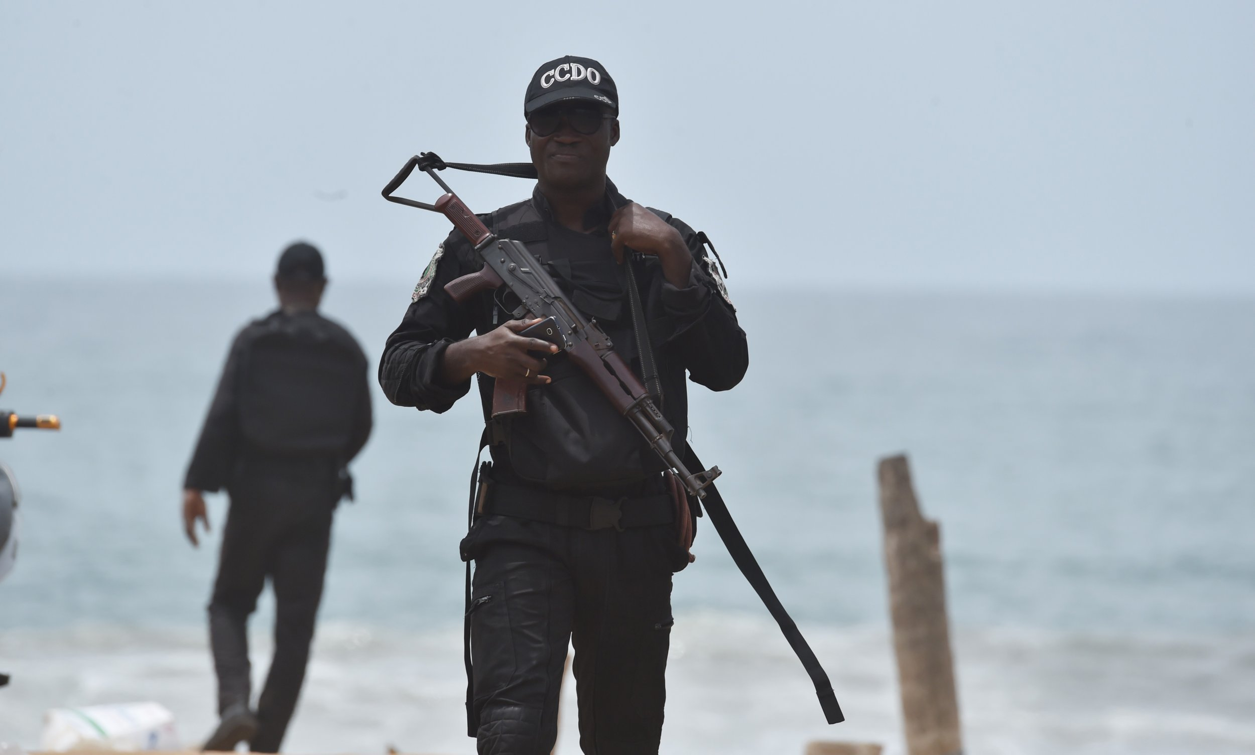 A soldier patrols on the beach in Grand Bassam, Ivory Coast, after an Al-Qaeda attack.