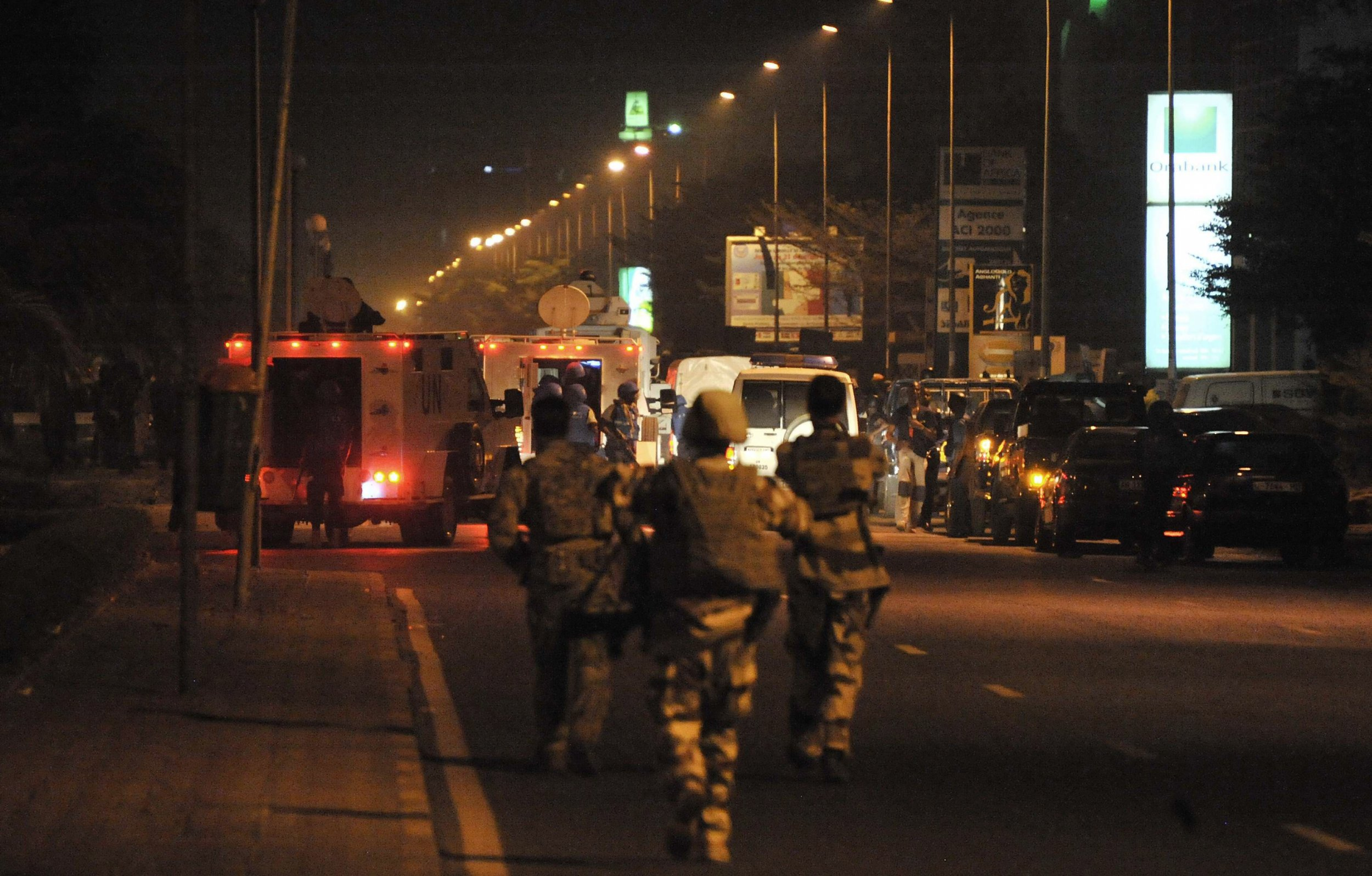European soldiers are seen after an attack on a hotel in Bamako, Mali.