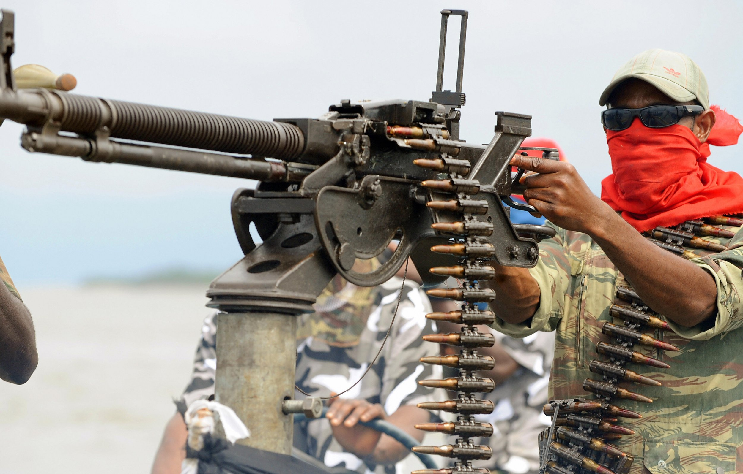 A MEND militant poses in the Niger Delta.