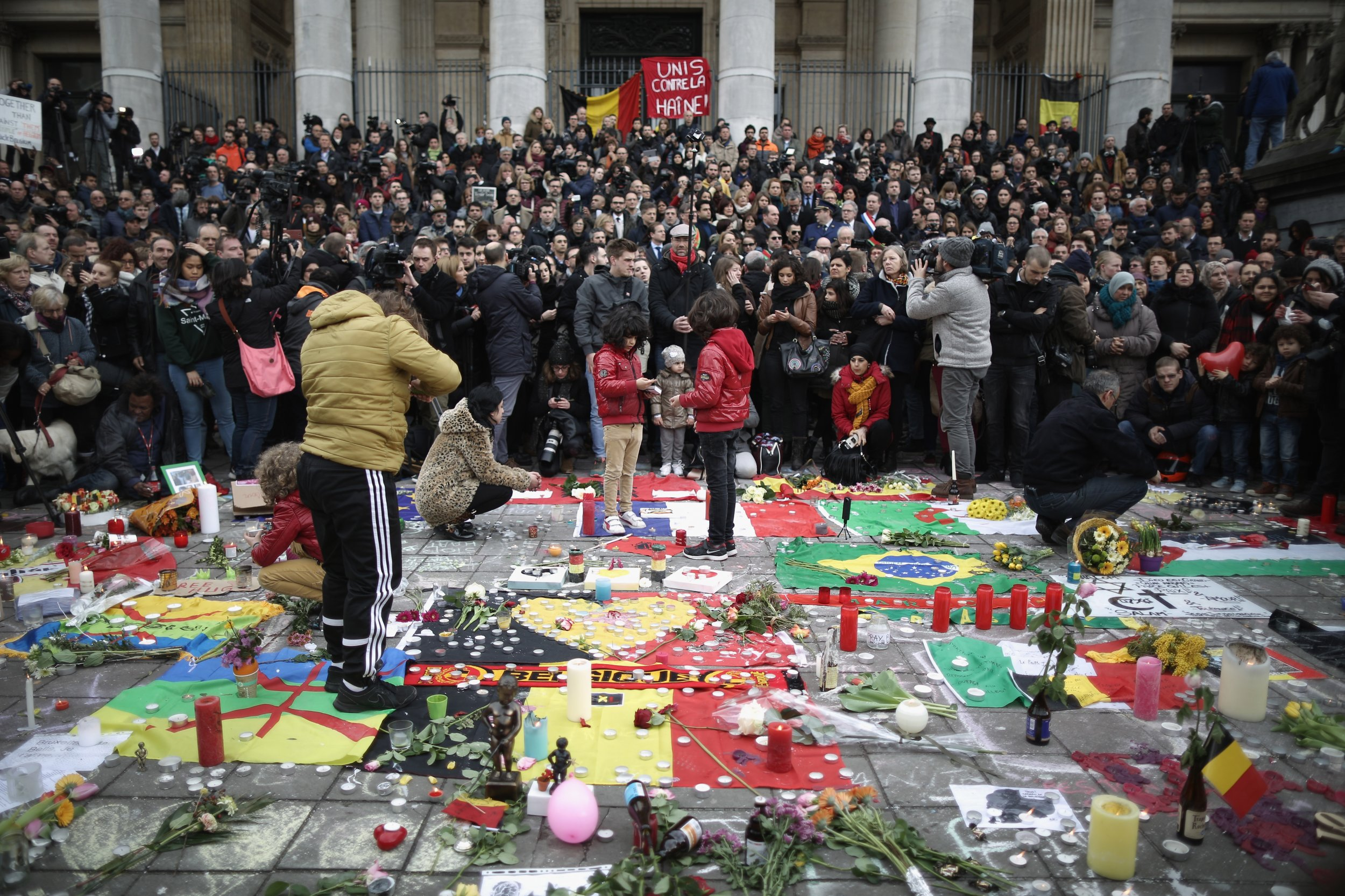 People observe a one minute silence at the Place De La Bourse, Brussels.