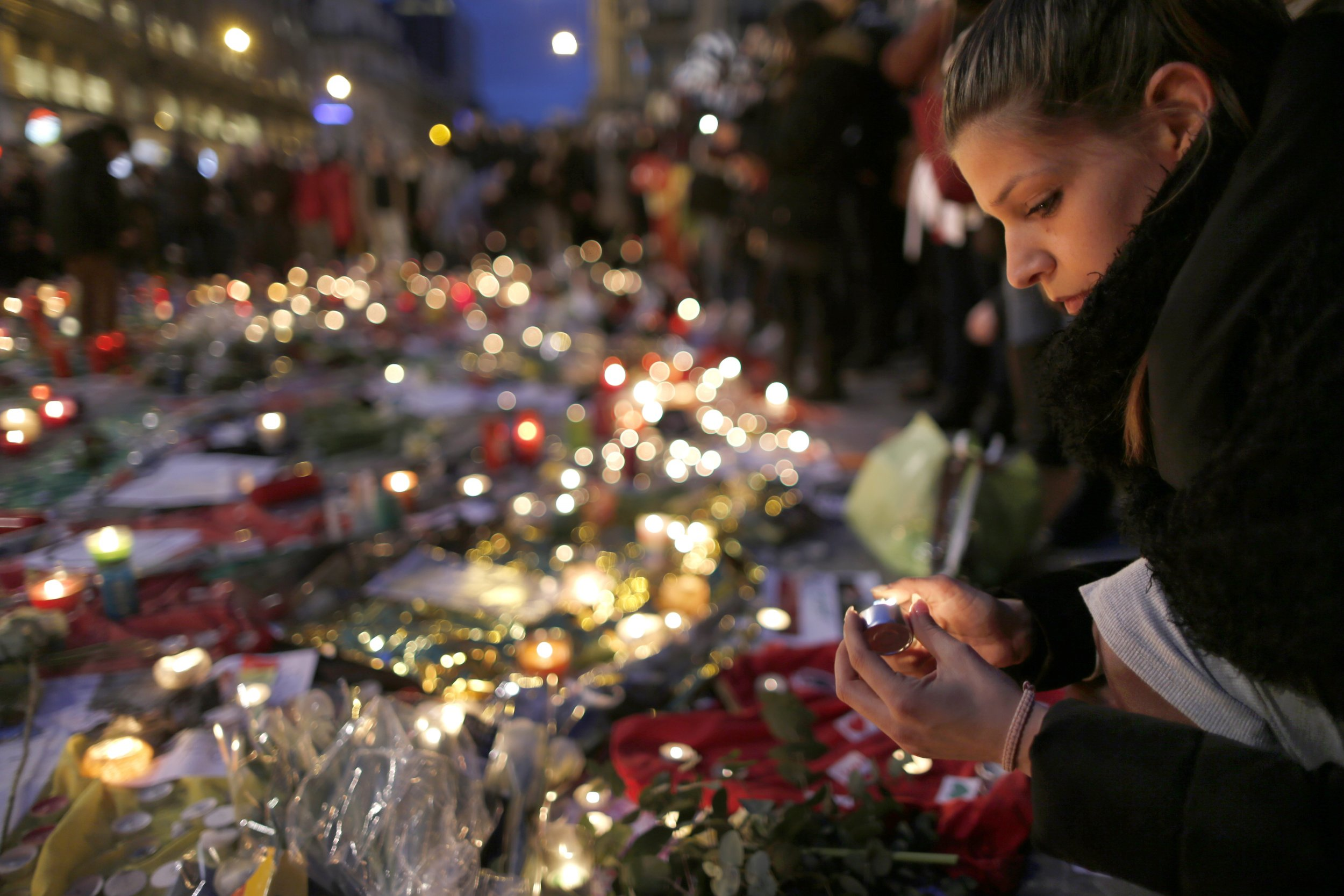 Woman attends street memorial for Brussels victims