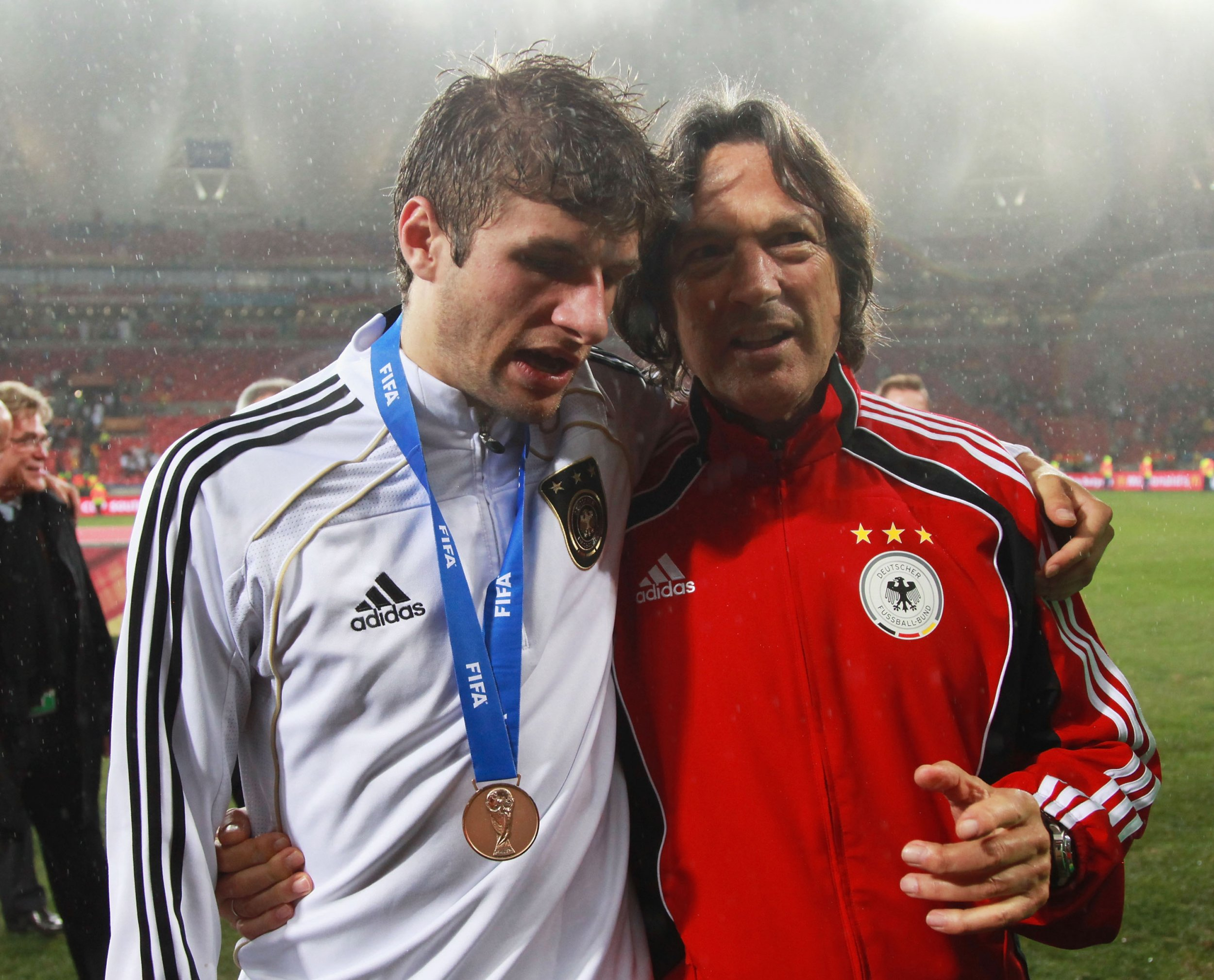 Hans-Wilhelm Muller-Wohlfahrt, right, is the Germany team doctor.