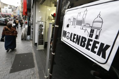 Molenbeek placard with peace and love sign in Brussels, Belgium.