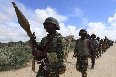 AMISOM peacekeepers in Burundi patrol in Mogadishu.