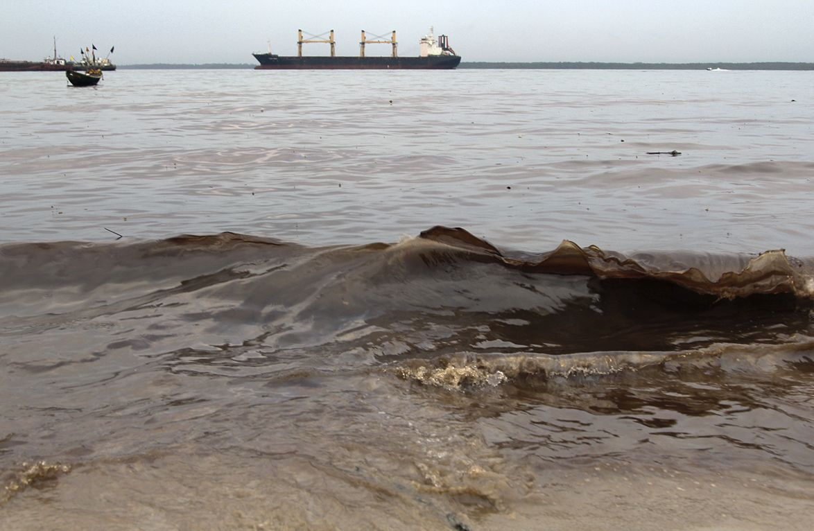 Oil washes up after a pipeline leak in the Niger Delta.