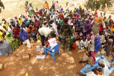 People rescued after being held captive by Boko Haram near its Sambisa Forest wait for medical treatment.